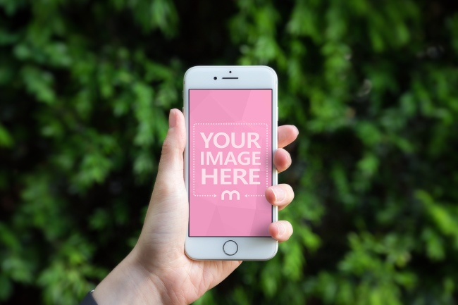 White iPhone in Hand Outdoors Mockup Generator preview image