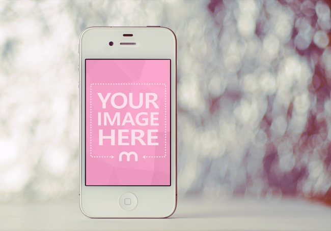 White iPhone Standing on Desk Mockup Generator preview image