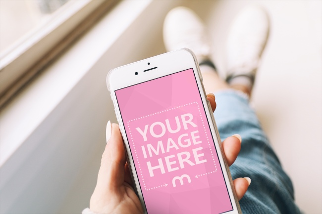 Closeup Woman Holding White iPhone in Hand Mockup Generator preview image