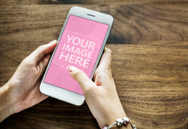 Woman Typing on White Smartphone Mockup Generator preview image