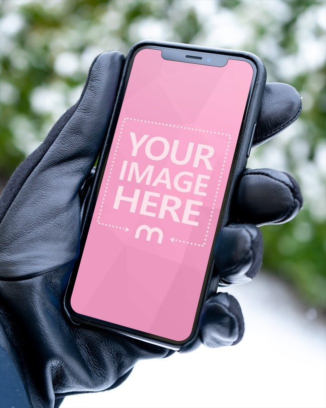 Man Holding iPhone X with Black Gloves Mockup Generator