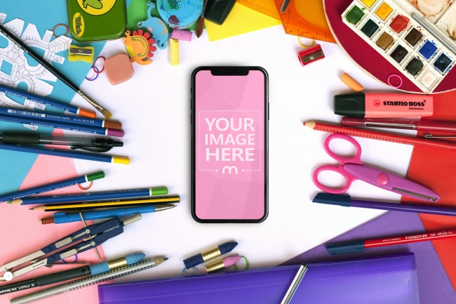 iPhone XS Surrounded by Office/School Equipment Mockup Generator preview image