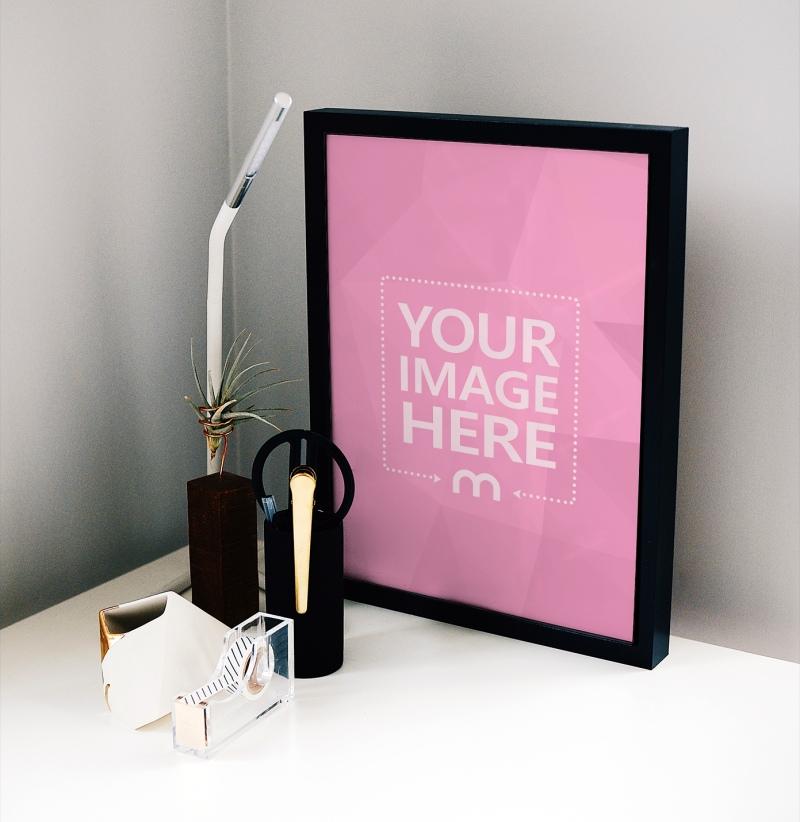 Portrait Poster Frame Standing on Desk Mockup Generator preview image