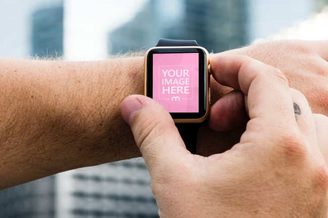Man Using Apple Watch Outdoors Mockup Generator preview image