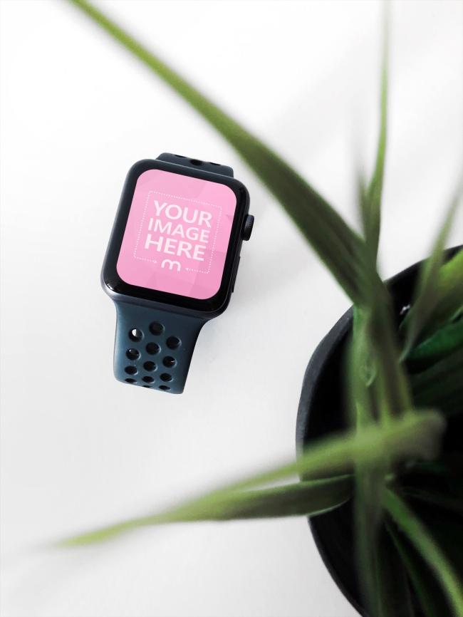 Smartwatch Lying on Desk Under Plant Mockup Generator preview image