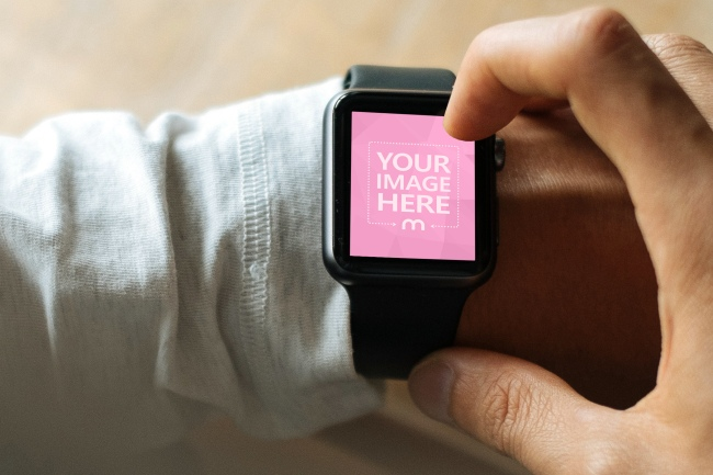 Closeup Man Tapping on Smartwatch Screen preview image