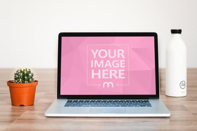 Macbook Laptop on Wood Floor Mockup Generator preview image