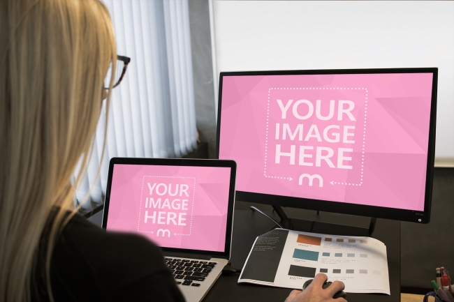 Woman Working on a Dual Screen Setup preview image