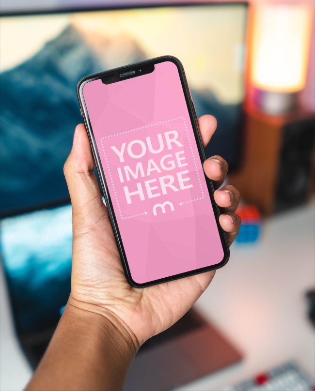 Man Holding iPhone X in Hand Mockup preview image