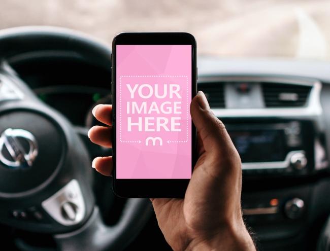 Smartphone in Hand on Car Interior Background Mockup Generator