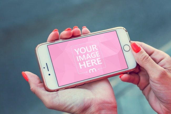Woman Holding White iPhone in Landscape Mode Mockup Generator preview image