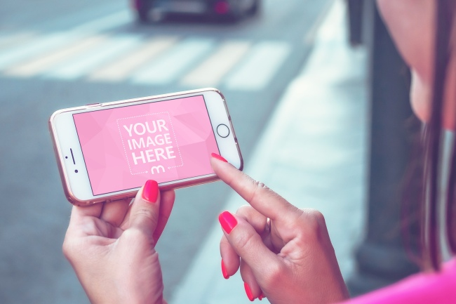 Woman Browsing on iPhone on the Street Mockup Generator preview image