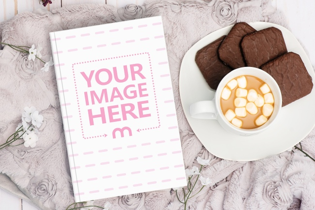 Book Lying Next to Coffee and Sweets Mockup Generator preview image