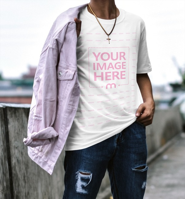 Man with Jacket Posing Outdoors T-Shirt Mockup Generator preview image