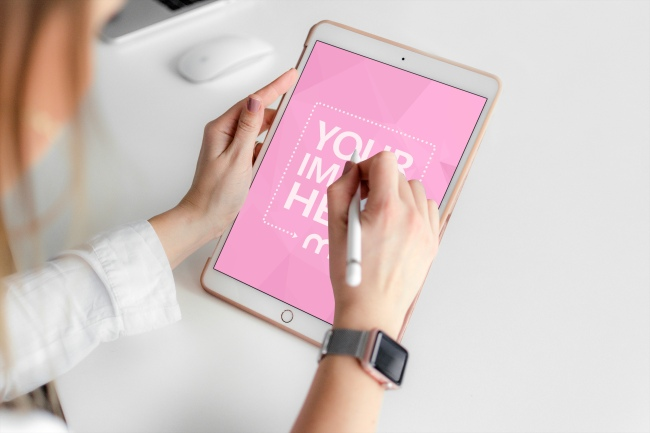 Woman Working with White iPad Mockup Generator preview image