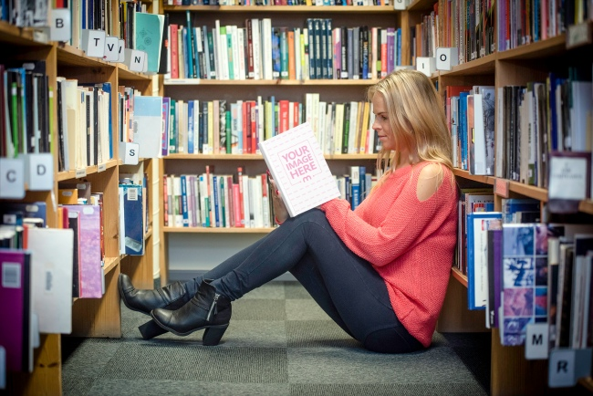 Girl Sitting on Library Floor and Reading a Book preview image
