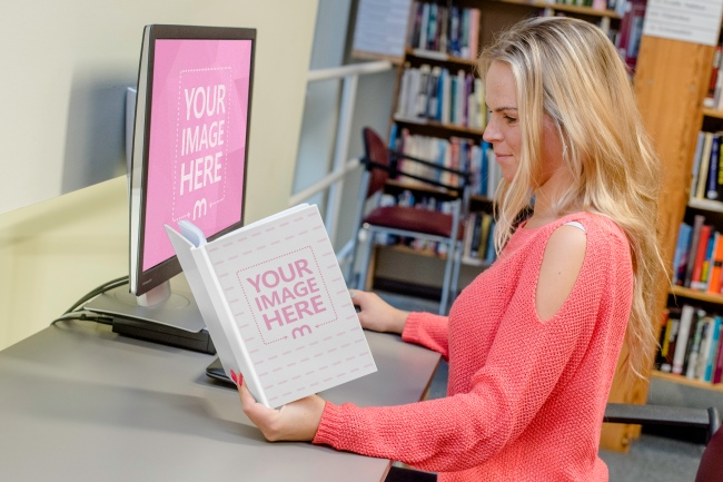 Woman Reading a Book and Using Computer at Library preview image
