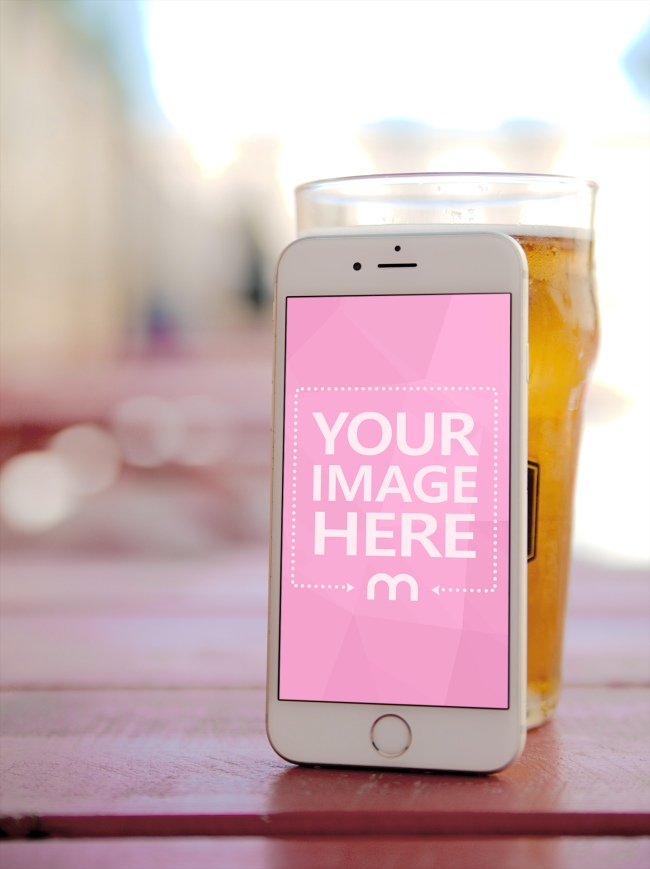White iPhone Leaning on a Beer Glass Mockup