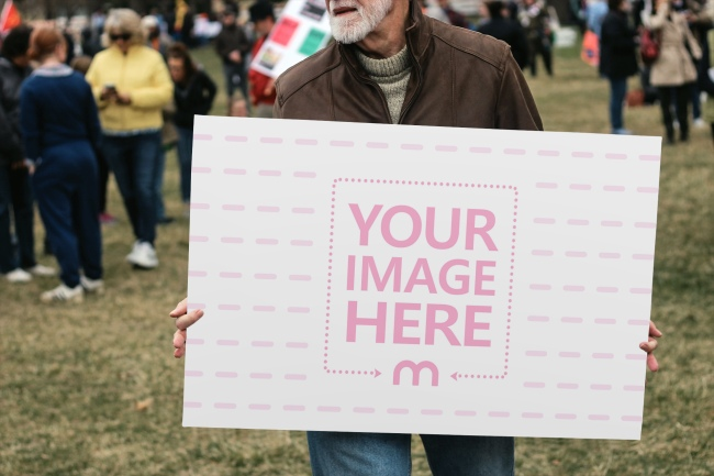 Man Holding Large Protest Sign Mockup Generator