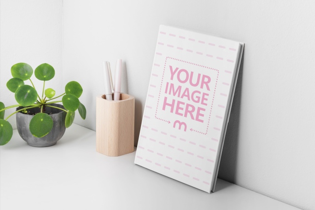 Hardcover Book Leaning on a Wall Mockup Generator preview image