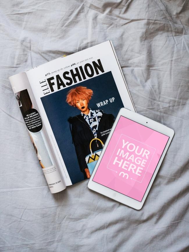 White iPad Lying on Fashion Magazine Mockup preview image