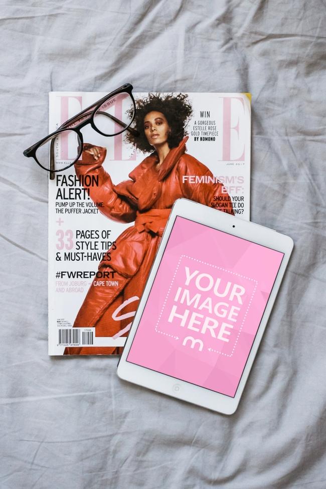 White iPad Tablet Lying on Fashion Magazine Mockup preview image