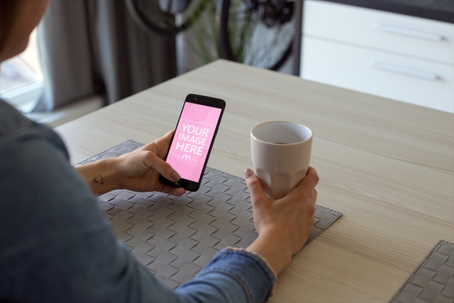 Woman Drinking Coffee and Browsing on Smartphone preview image