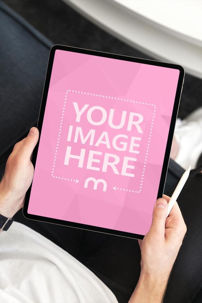 Portrait iPad in Hand Mockup