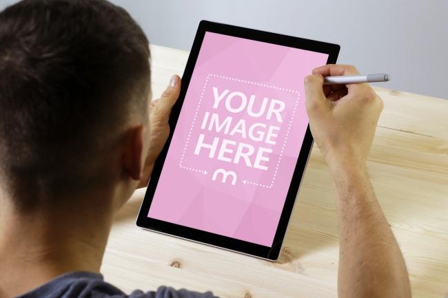 Man Using Surface Pro Tablet Mockup