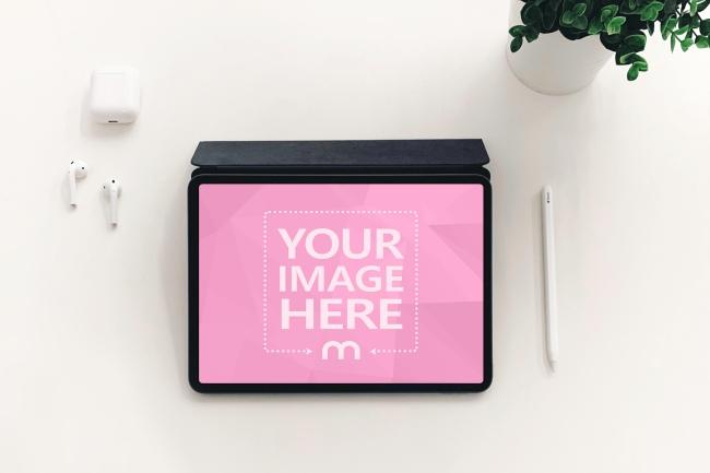 iPad Pro on White Desk Mockup