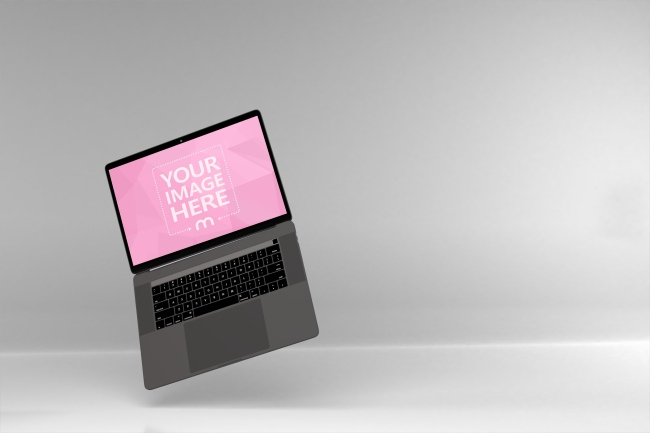 Standalone MacBook Pro on the Side of View