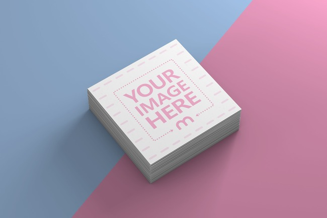Square Business Cards on Two-tone Surface Mockup preview image