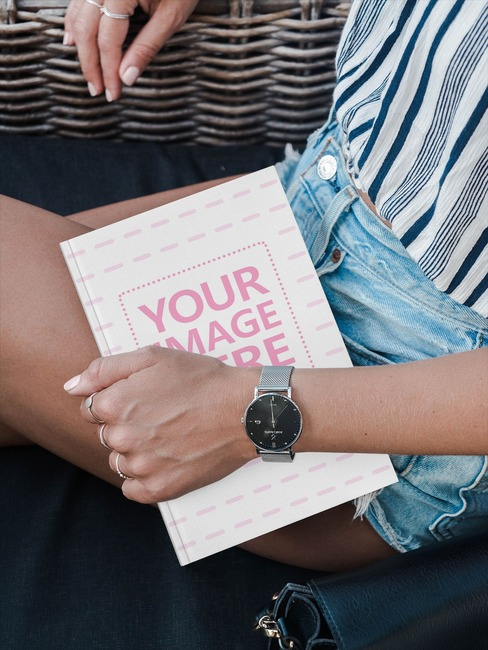 Young Woman Holding Book Mockup