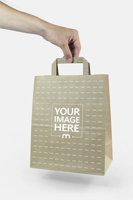 Holding Brown Paper Bag in Hand Mockup preview image