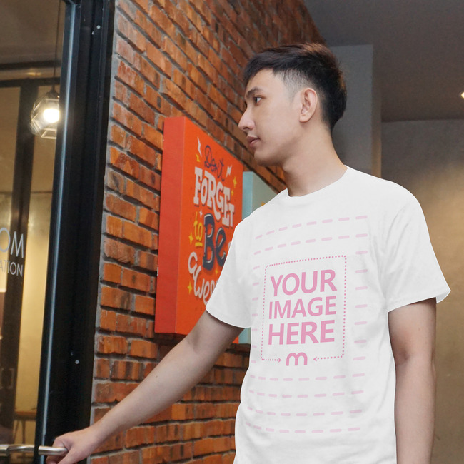 T-Shirt Mockup with a Young Man Opening a Door preview image