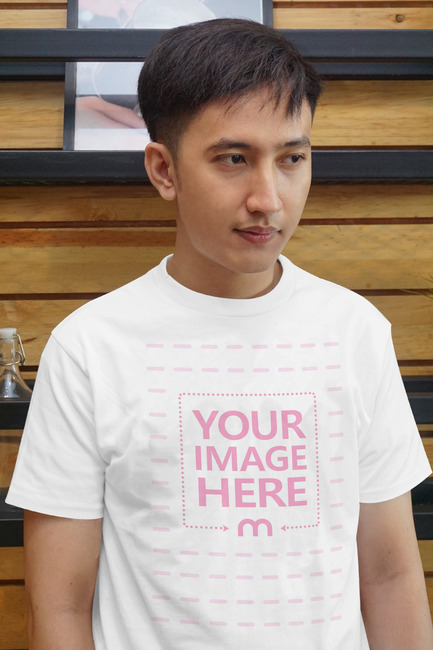 A Shirt Mockup of a Serious Looking Young Man preview image