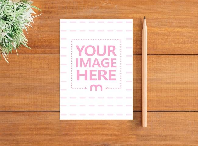 Vertical Postcard on Wood Desk Mockup preview image