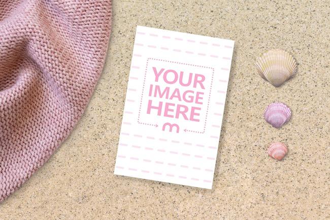 Postcard on a Beach Next to Seashells