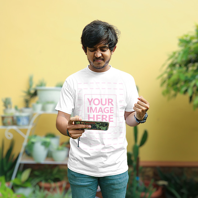 Shirt Mockup of a Young Man With His Phone