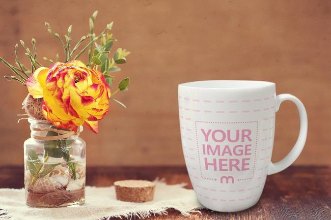 Coffee Mug Next to Vase Mockup preview image