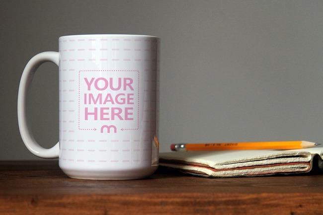 Coffee Mug Next to Notebook Mockup Generator preview image