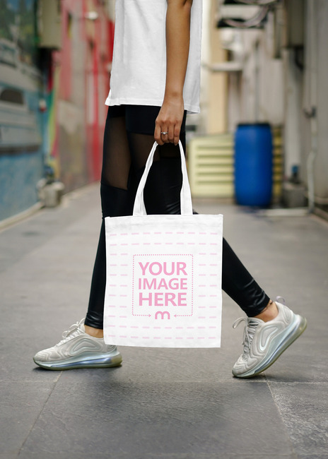 Woman Holding Tote Bag Mockup preview image