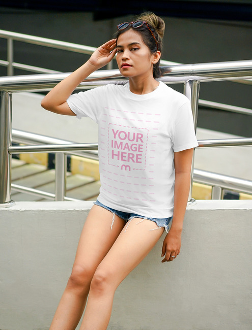 T-Shirt Mockup Featuring Sitting Young Woman preview image