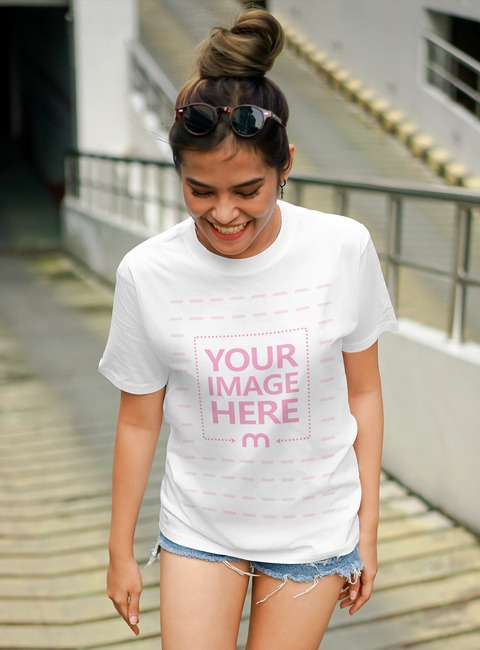 T-Shirt Mockup Featuring a Smiling Girl preview image