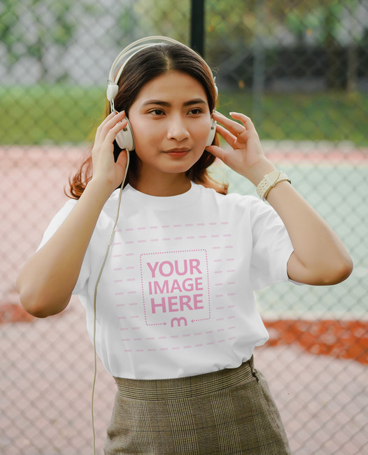 T-Shirt Mockup With a Woman Wearing Headphones preview image
