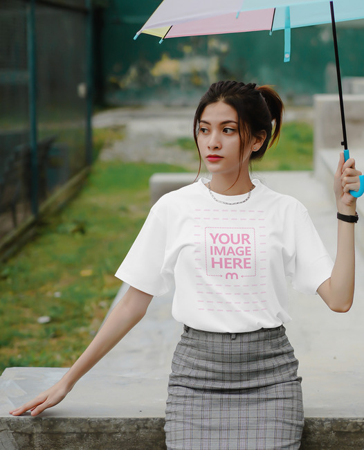T-Shirt Mockup Featuring Woman Holding an Umbrella preview image