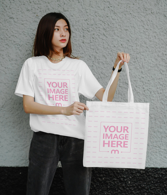 Tote Bag and Shirt Mockup With a Woman Holding the Bag preview image