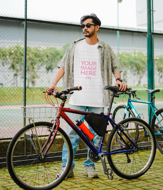 T-Shirt Mockup With Man Holding His Bike preview image