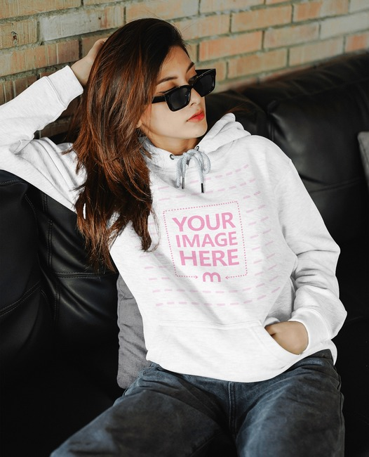 Hoodie Mockup Featuring a Sitting Woman With Sunglasses preview image
