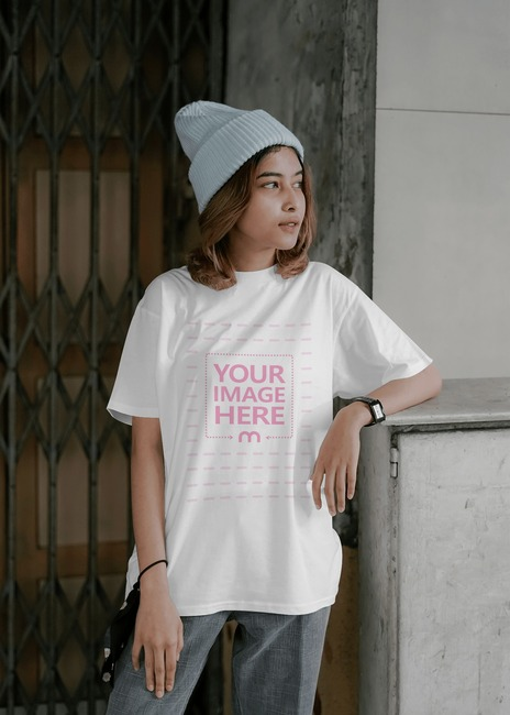 T-Shirt Mockup With a Posing Young Woman preview image
